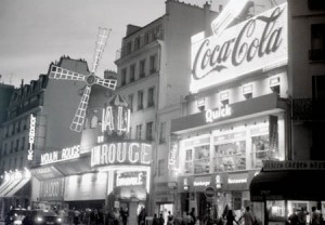 Black and white film photograph of the Moulin Rouge, Paris